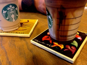 Iced Starbucks with coasters made by local artist and sold at the Texas Folklife Festival, 2015.